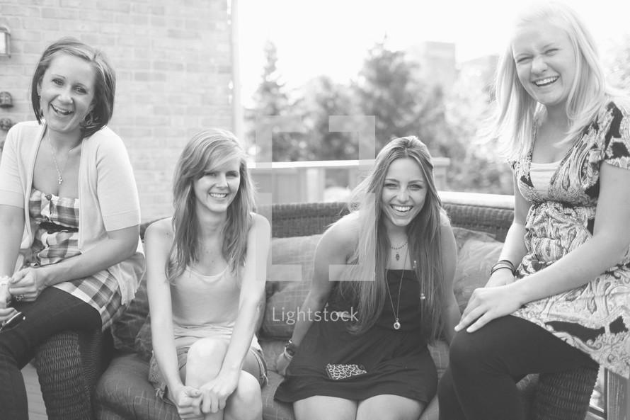 teen girls sitting together smiling
