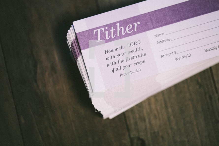 tithes and offering envelopes stacked