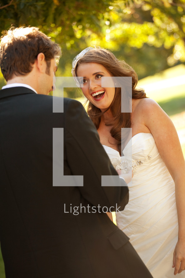 A bride and groom laughing