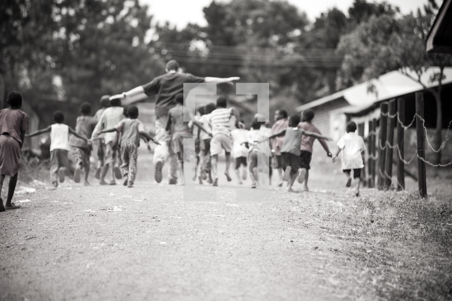 man leading a group of children
