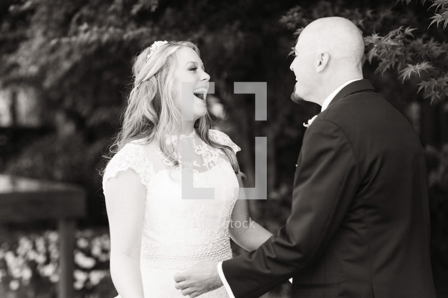 A bride and groom laughing together wedding day husband and wife