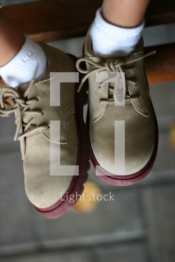 The feet of a young child.