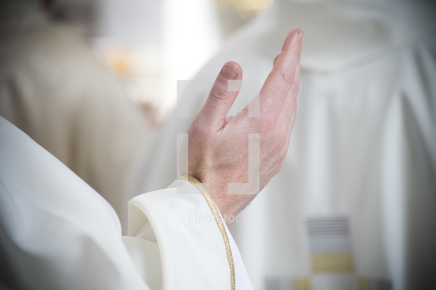 priests hand in blessing