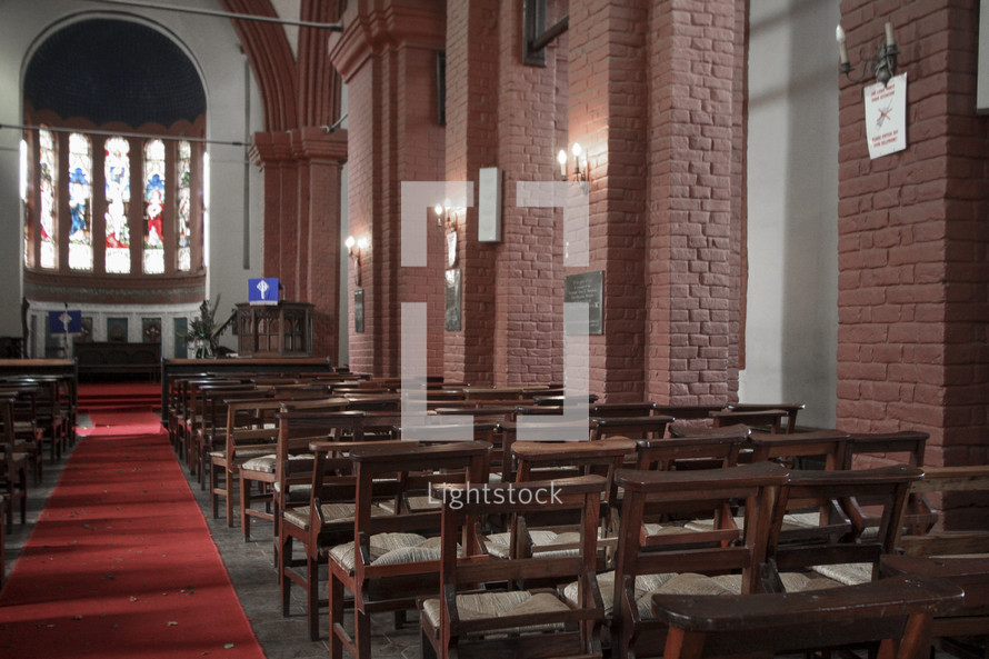 rose petals down the aisle of an empty church