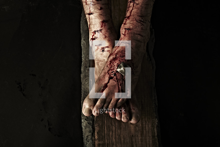 The feet of Jesus nailed to the cross