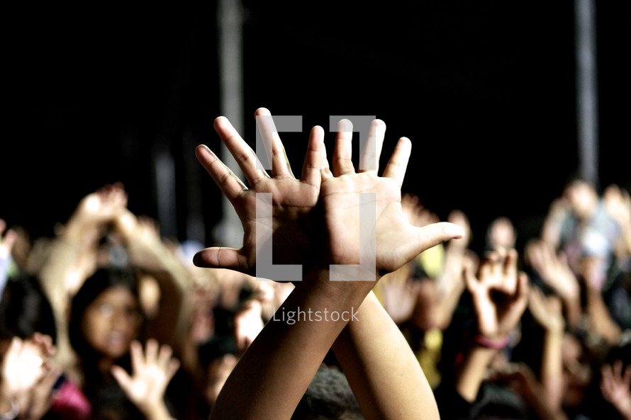 Hands raised during corporate worship