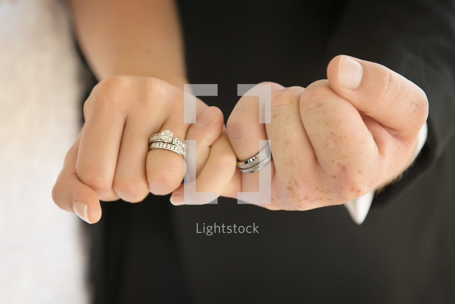 Couple showing their wedding rings
