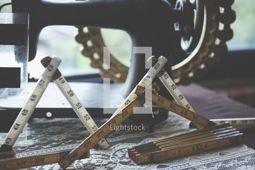 measuring stick and a sewing machine
