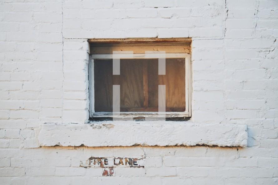 boarded basement window