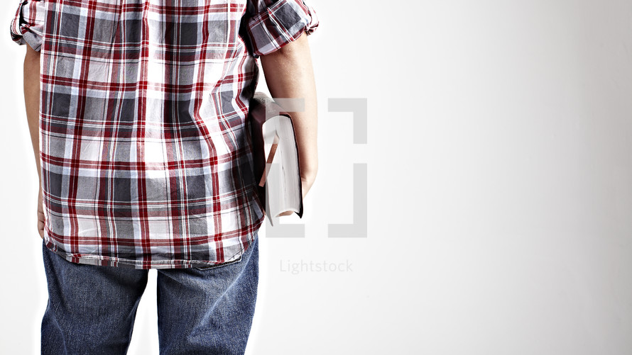Boy holding a Bible