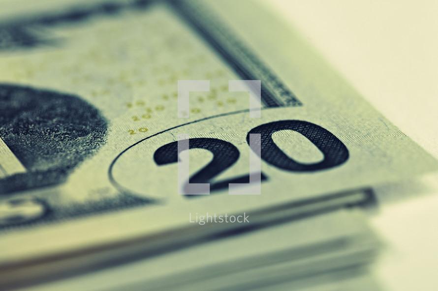 A stack of twenty dollar bills