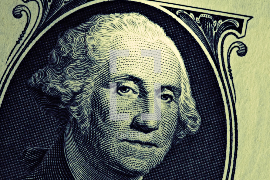 A close up of George Washington on a one dollar bill