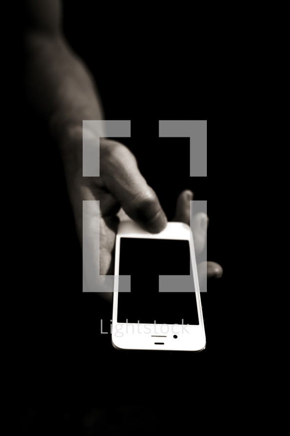A hand holding an iphone
