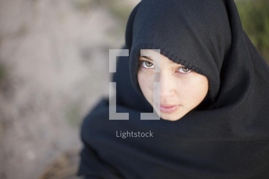 Girl in cloak