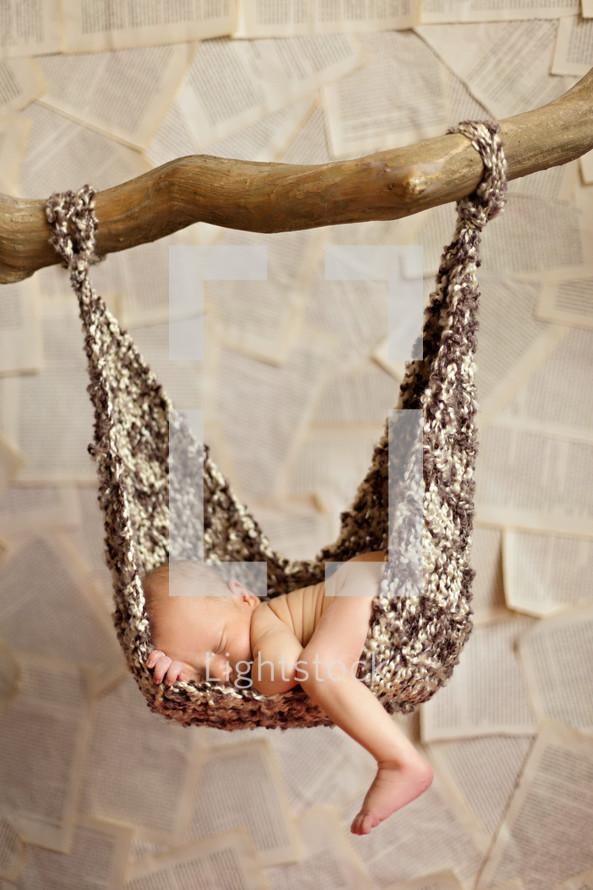Newborn lying in hammock