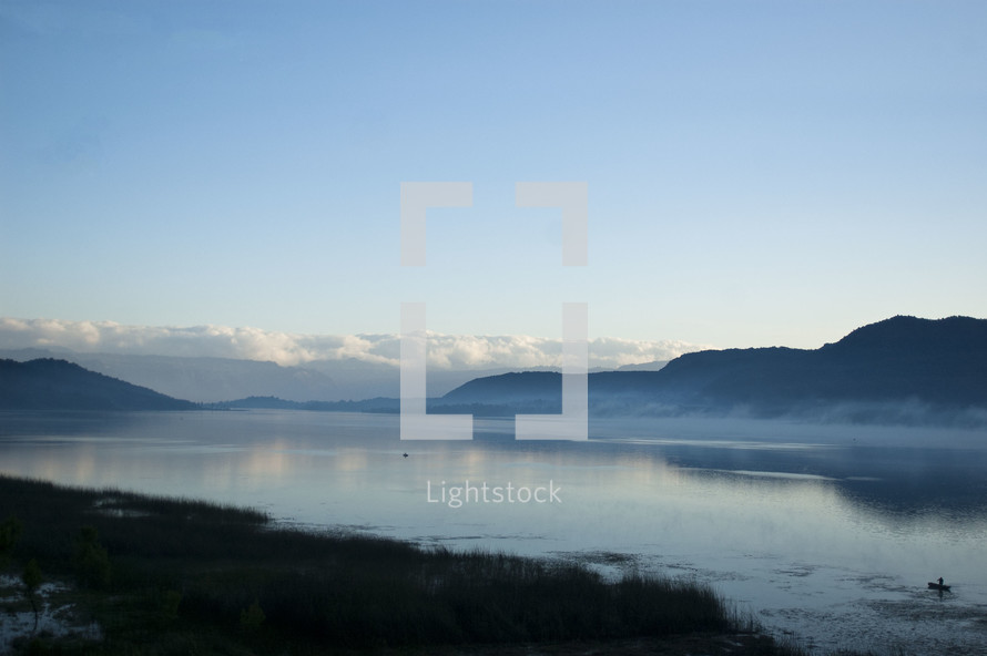mist over a lake