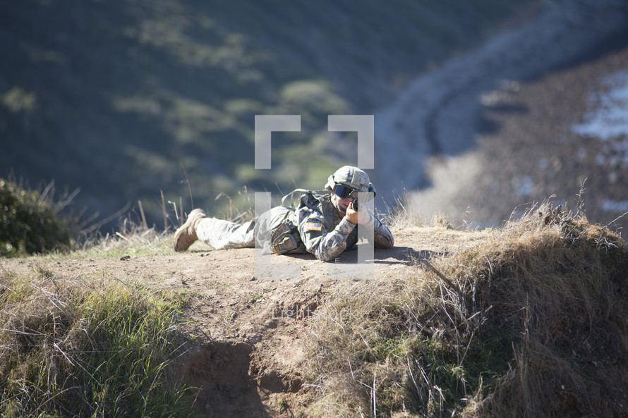 soldier aiming his rifle