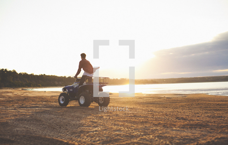 four wheeler driving on the beach