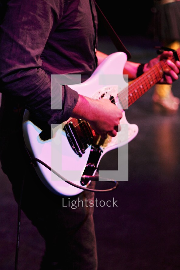 A man playing a guitar.