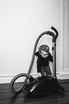 toddler with a vacuum