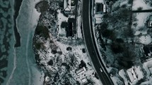aerial view over a winter coastal highway