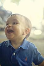 giggling toddler boy