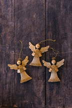 gold angel ornaments on wood background
