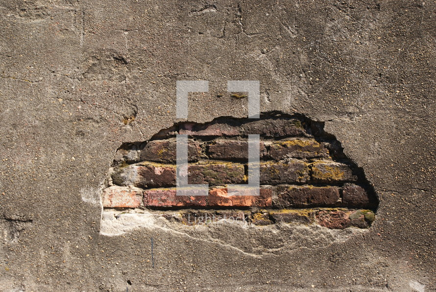 exposed brick on a plastered wall