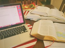 laptop, open Bibles, and journals on a table at a Bible study