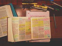 An open Bible with highlighted verses and Bible study tools.