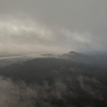 fog and clouds over a mountain range