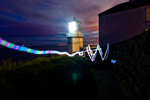 light from a lighthouse and streaks of light
