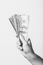 Hand holding paper money.