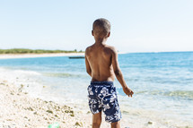 a boy child on a beach