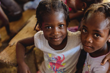 children hugging in Haiti