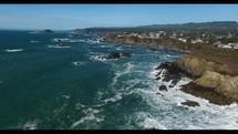 Aerial Video Flying Over Rocky Coastline at High Tide