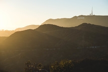 sunlight shining over Hollywood sign