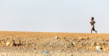 running across the desert in Ethiopia