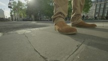 man in boots on a sidewalk - editorial use only