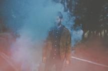 a man holding a smoke flare