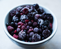a bowl of frozen berries