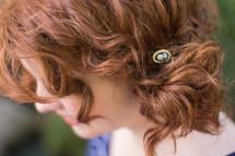 barrette in a redhead's hair
