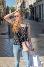 a young woman shopping in a city