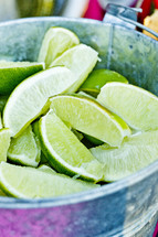 A bucket of lime slices fresh