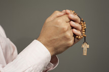 man holding a rosary