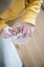 a child eating candy Easter eggs