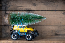 toy car with a bottle brush Christmas tree