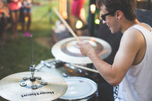 drummer playing drums at an outdoor concert