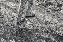 boy with a hiking stick