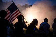 teens around smoke and fireworks at night